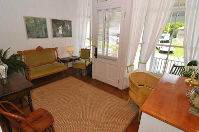 inside entrance of cottage with hardwood floors brown rug wooden desk with chairs