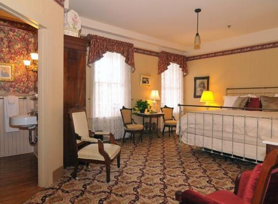 Image of Antique Iron Bed in Victorian Room with Bathroom Atlantic Hotel