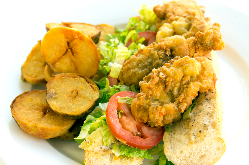 Oyster Poboy with French Fries on white plate